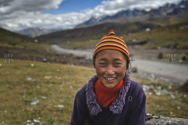September 19, 2011: Tibetan kids from nomad families wander around their camp sites during day and greet their visitors. Tibetan plateau