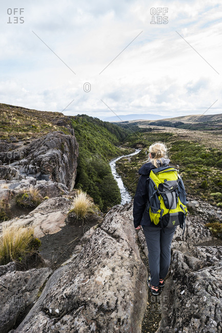 April 9, 2016: Tongariro National Park, woman looks out over valley and gorge, Lord of the Rings location, Mordor, Tongariro, New Zealand