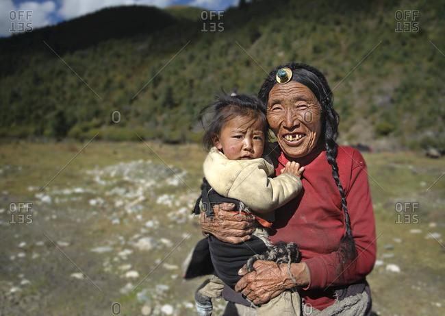 September 25, 2011: Tibetan families stick together. While parents work, grandparents are in charge of looking after their grandchildren. Remote Tibetan plateau