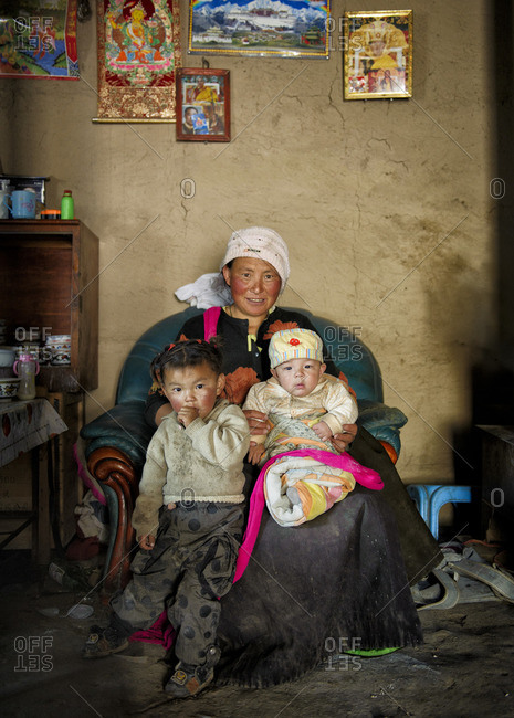 September 26, 2011: Tibetans live in modest homes, all together, with their walls covered by religious icons and posters. Remote Tibetan plateau
