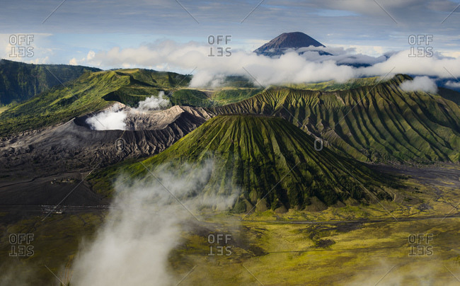 Active crater of Bromo on the left, volcano Batok in front and volcano Semeru behind, Bromo Tengger Semeru National Park, Java Island, Indonesia