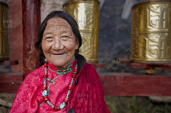 September 23, 2011: Tibetan women circumbalate the monasteries making the praying wheels spin in order to lift their prayers to heaven. Remote Tibetan plateau
