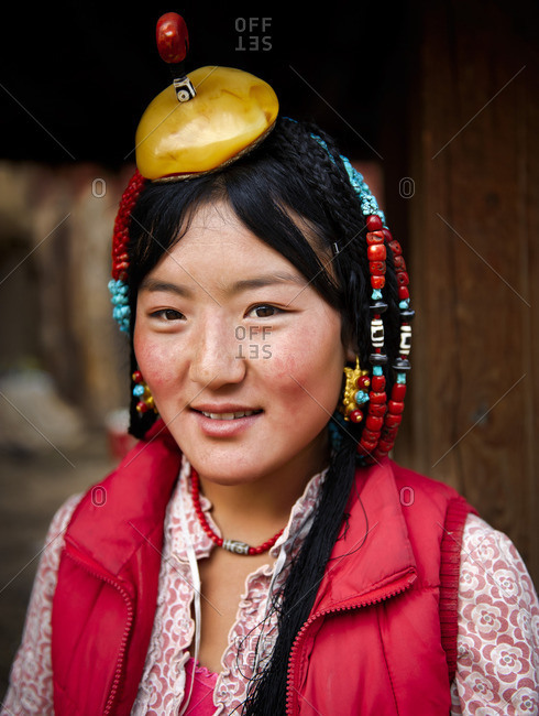 September 25, 2011: Some families strive to preserve their traditions. Customs and way of dressing and accessories are from generation to generation. Remote Tibetan plateau
