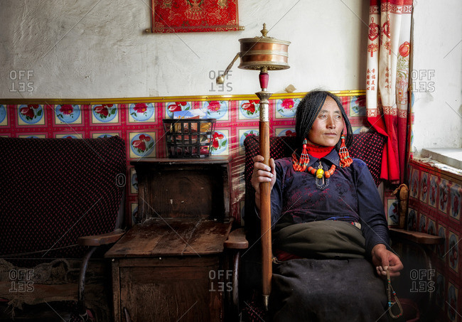 October 8, 2011: Tibetans are very devote buddhists and at all ages they spend long hours reciting their mantras using their praying wheels. Remote Tibetan plateau