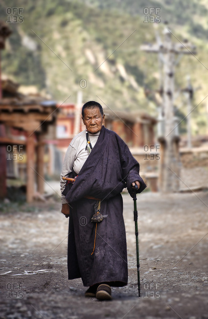 September 23, 2011: Tibetans are very devote buddhists and at all ages they spend long hours reciting their mantras using their praying wheels. Remote Tibetan plateau