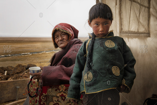 October 3, 2011: Tibetan families stick together. While parents work in the fields herding yaks, grandparents are in charge of looking after their grandchildren. Remote Tibetan plateau