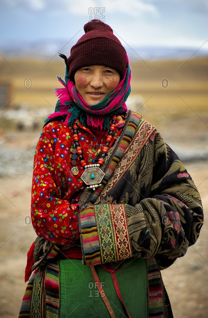 October 4, 2011: Tibetans deep in remote regions of the plateau still preserve their traditions, wearing the clothes and accessories of their respective tribes. Remote Tibetan plateau