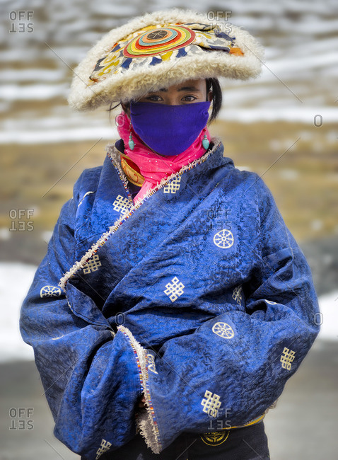 September 30, 2011: Tibetans deep in remote regions of the plateau still preserve their traditions, wearing the clothes and accessories of their respective tribes. Remote Tibetan plateau