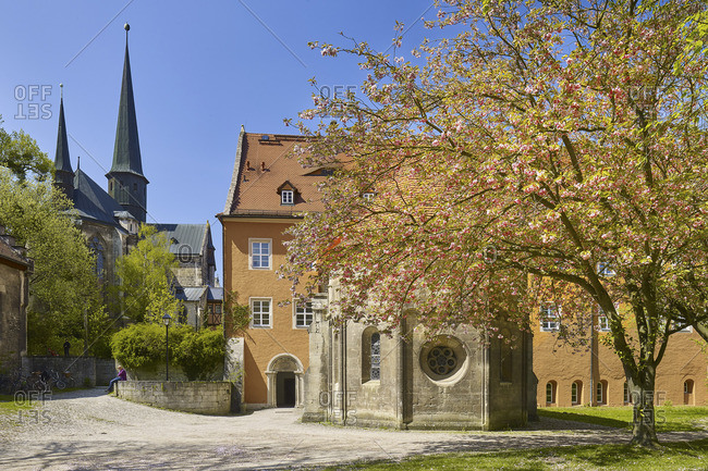 April 30, 2017: Monastery church and abbey chapel with entrance to the Princely House from the east, Pforta Monastery in Schulpforte, part of the Naumburg district of Bad Kosen, Saxony-Anhalt, Germany