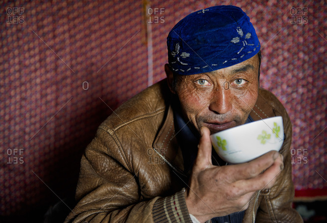 May 17, 2010: Uighur men are original from Central Asia and it is very common to see the mix of facial features between east and west as emerald green eyes. Remote Xinjiang