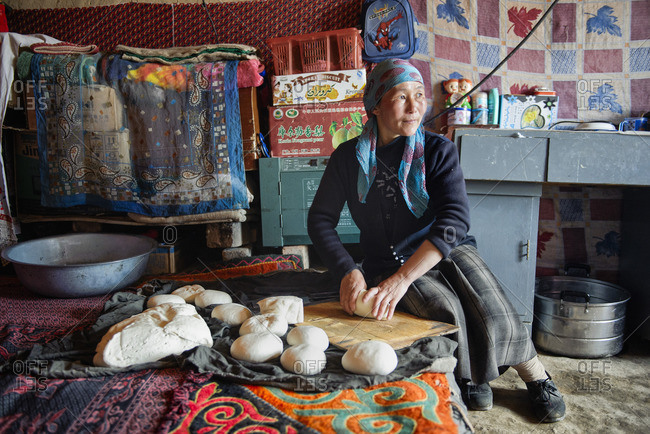May 17, 2010: Traditional Uighur women in remote Xinjiang stay all day in the house doing the daily chores. Cooking, baking bread, preparing tea, look after the children, while the men work outside.