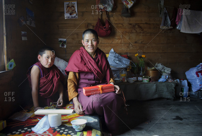 September 23, 2011: Tibetan monks live in communities. Their cloisters are very basic and their belonging are limited to robes, a few religious figures, a wooden bed and the praying sheets. Kasongdu village. Remote Tibetan plateau