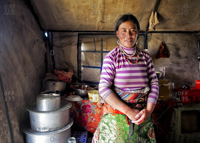 October 4, 2011: The kitchen and its stove is where TIbetans spend most of their time when at home. It keeps them warm. There their wealth is measured by the amount and quality of the pots they own. Remote Tibetan plateau