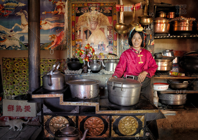 September 27, 2011: The kitchen and its stove is where TIbetans spend most of their time when at home. It keeps them warm. There their wealth is measured by the amount and quality of the pots they own. Remote Tibetan plateau