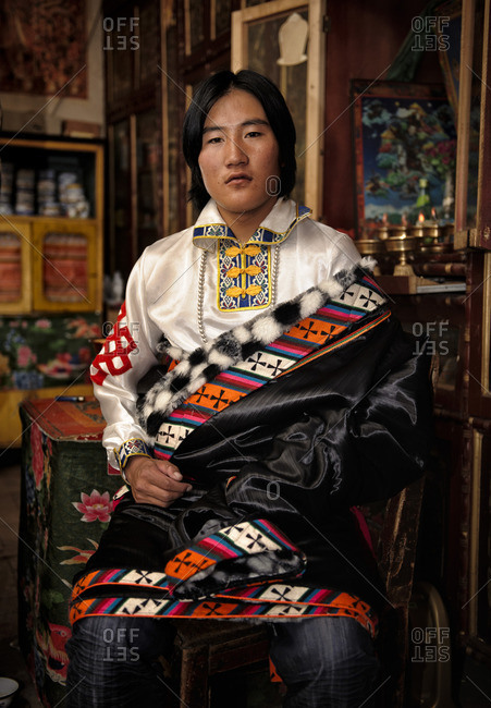 October 7, 2011: Tibetans marry very young, most of the time the marriages are arranged by their families. The celebration begins several days before the wedding. In them they dress their most exquisite  clothes to host a great number of friends and relatives that will visit her during those days. Remote Tibetan plateau