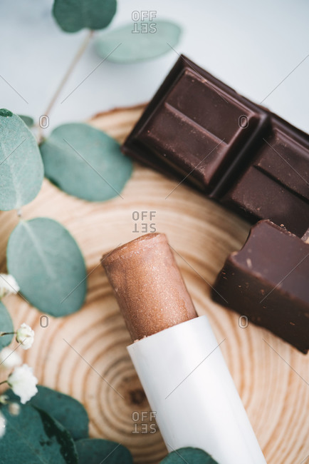 Overhead of handmade cocoa and shea butter lip balm