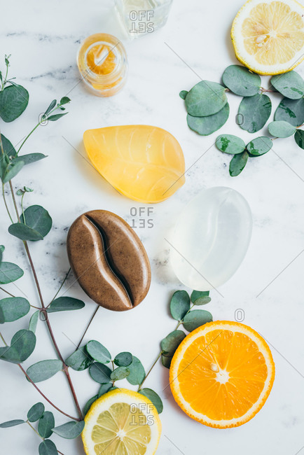 Overhead view of natural organic handmade glycerin soaps on marble surface