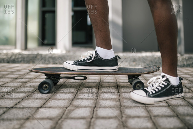 Feet of young black man skating on a skate