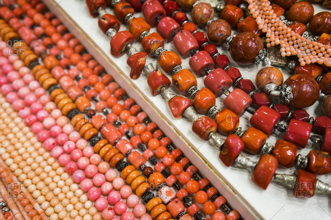 Red beaded necklaces for sale at a bazaar in Madaba, Jordan.