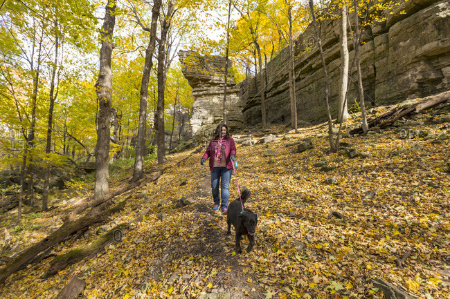 Woman walking dog in High Cliff State Park, Sherwood, Wisconsin, USA