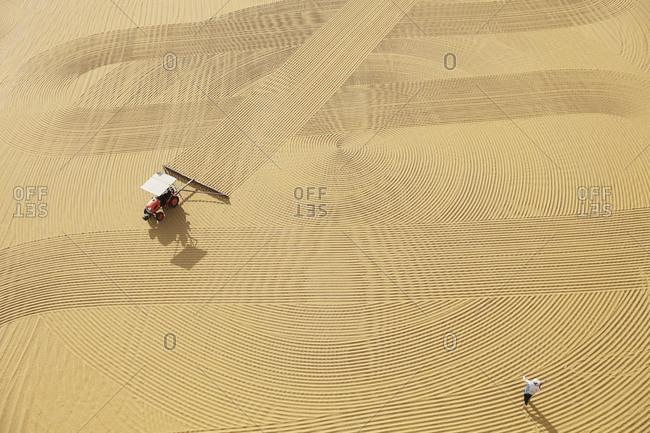Tractor ventilation on wheat during drying process, Gaziantep, Southeastern Anatolia, Turkey