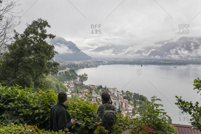 Two men looking at scenic landscape, Montreux, Vaud, Switzerland