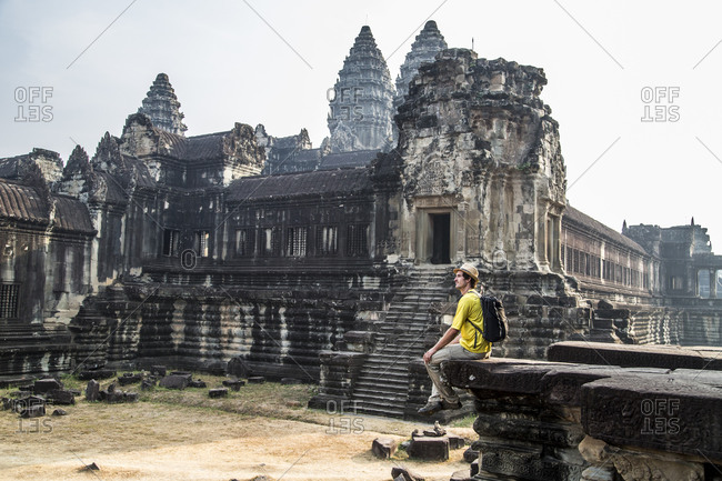 Tourist inside Angkor Wick temple complex, Sieck Reap, Cambodia