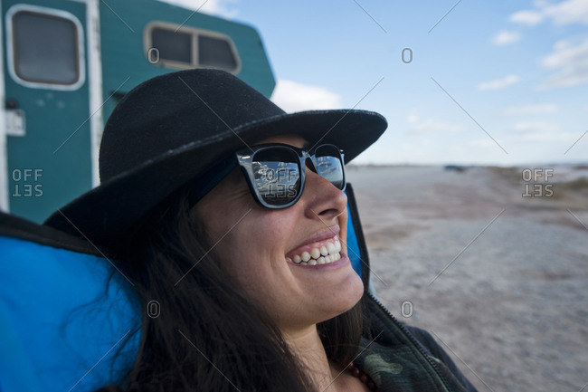 Young woman relaxing outdoors, New Mexico, USA