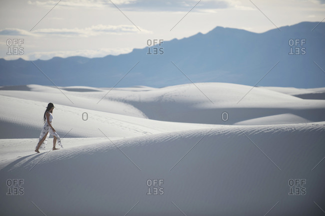 Woman walking in desert, White Sands National Monument, New Mexico, USA