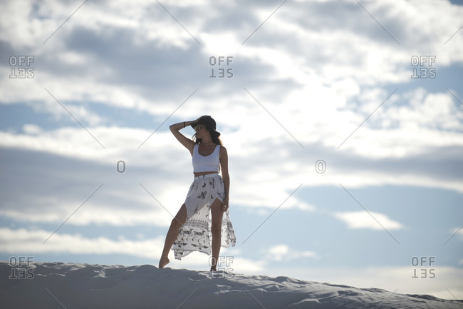 Woman standing in desert, White Sands National Monument, New Mexico, USA