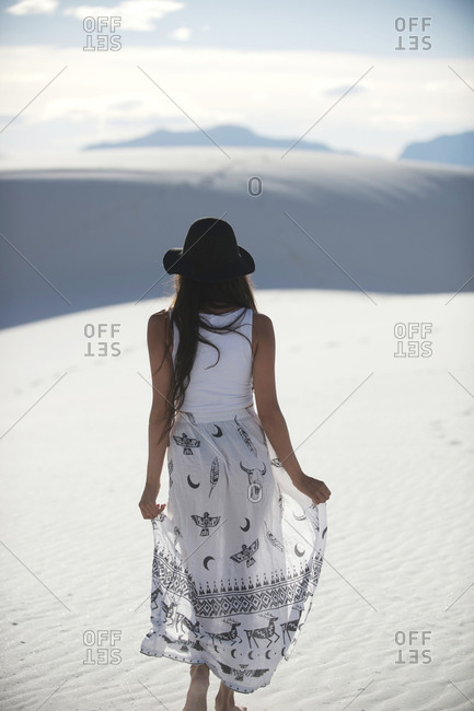 Woman in hat in desert, White Sands National Monument, New Mexico, USA