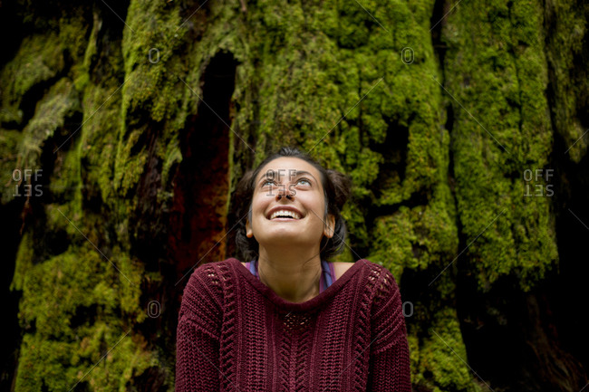 Woman looking up in redwood forest, Redwoods, California, USA
