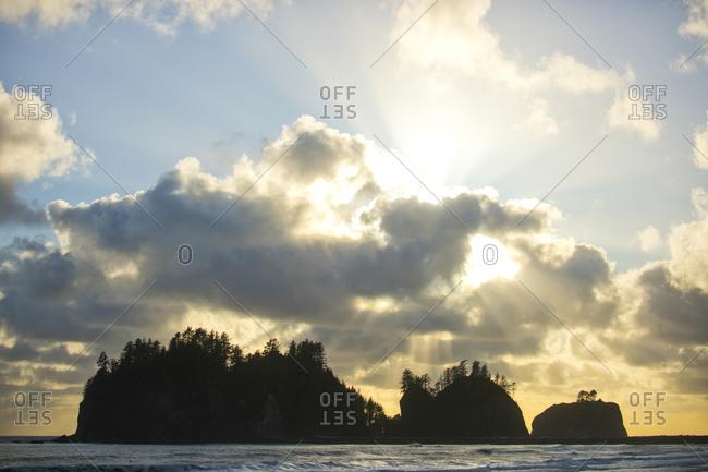 Sun setting over small island, Washington, USA