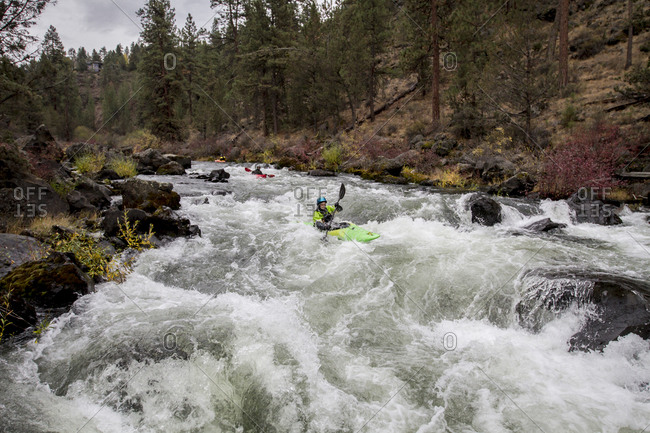 United States, CA, Bend - October 19, 2016: Kayakers in Deschutes River, Oregon, USA