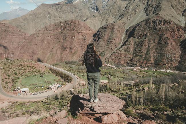 Hiker admiring landscape of Atlas Mountains, Marrakesh, Morocco