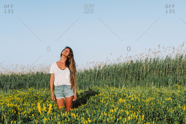 Woman standing in green meadow, Mallorca, Balearic Islands, Spain