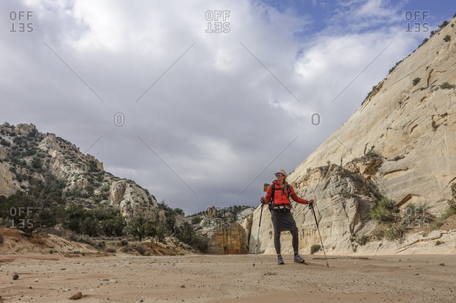 Female hiker in desert, Hayduke Trail, Utah, USA