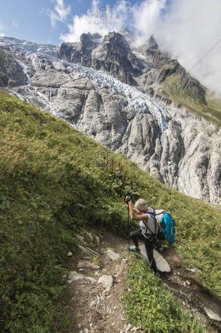 Senior woman hiking along Haute Route Traverse Monck Blank massif, Switzerland