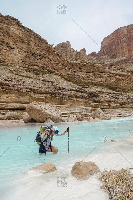Woman wading in Colorado River, Grand Canyon, Arizona, USA