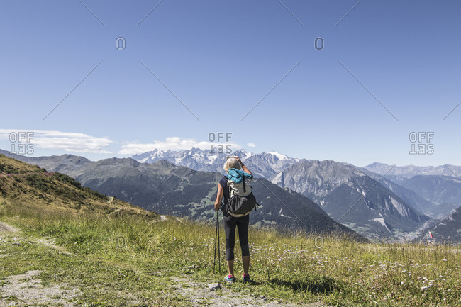 View of senior woman looking at view, Valais, Switzerland