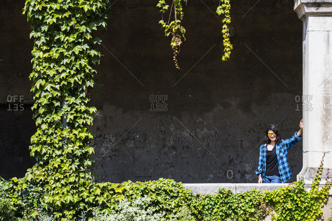 Woman posing in archway, Lyon, Auvergne-Rhone-Alpes, France