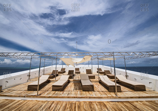 Sun loungers on stern of luxurious yacht, Maldives