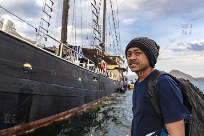 portrait of man disembarking old Dutch schooner