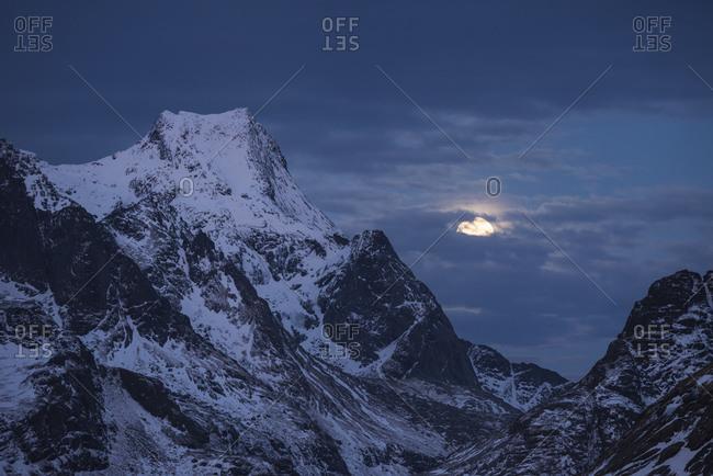 Winter moon next to Storskiva mountain peak,  Loftin Islands, Norway