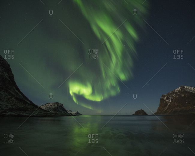 Northern Lights - Aurora Borealis fill sky over Vik beach, Vested, Loftin Islands, Norway
