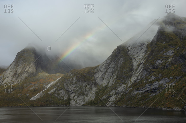 Clearing autumn storm over Djupfjord and Munken mountain peak, Muskiness¸y, Loftin Islands, Norway