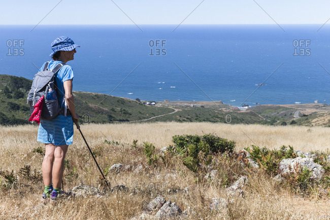 A female hiker looks down from the Pomo Canyon Red Hill Trail in Sonoma County.