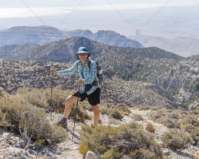Front view of a female hiker on her way to the top of Notch Peak.