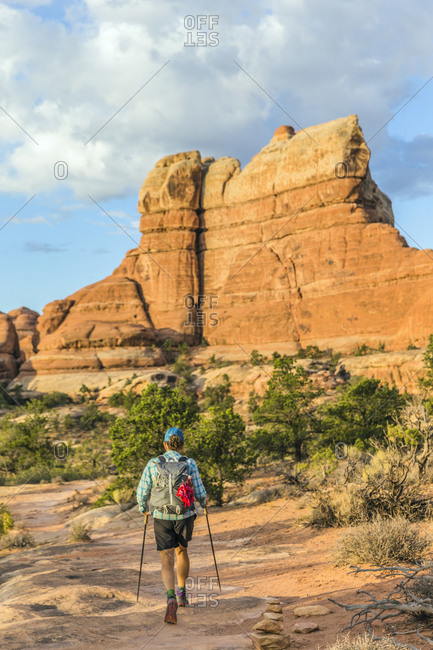 Rear view of a female hiker on the Chester Park Trail in the Canyonlands National Park Needles District.