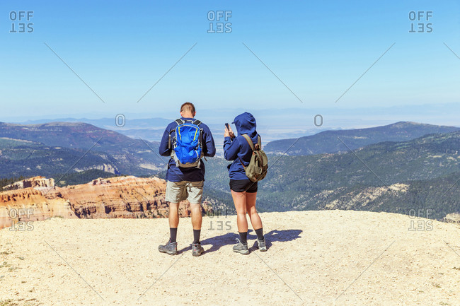 A couple enjoy the scenic view of Cedar Breaks National Monument.